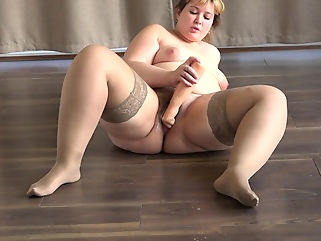 A fat woman masturbating her hairy pussy with a sex toy fetish amateur films